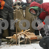 Rob Winner – rwinner@shawmedia.com<br /> <br /> Aaron Trier (right), 11, of Sycamore Cub Scout Pack 822 closely watches a flame started by a match he struck while building a fire during the annual Klondike Derby held at Sycamore's Sportsman's Club in Sycamore, Ill., Saturday, Feb. 2, 2013.