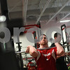 Kyle Bursaw – kbursaw@shawmedia.com<br /> <br /> Northern Illinois University football players Sean Folliard does front squats as teammate Austin Smaha (behind Folliard) waits for his turn as the two lift with teammates in the Yordon Center on Friday, Feb. 1, 2013.
