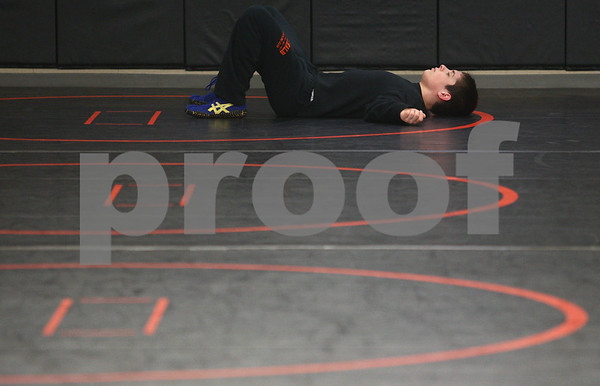 Kyle Bursaw – kbursaw@shawmedia.com<br /> <br /> DeKalb wrestler Nick Roach takes a moment to lay on the mats during a water break at practice on Tuesday, Feb. 5, 2013.