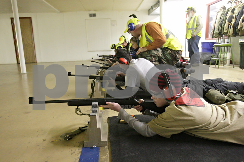 Rob Winner – rwinner@shawmedia.com<br /> <br /> Kenny Brown (bottom), 13, of Sycamore Boy Scout Troop 16 prepares to fire a rifle during the annual Klondike Derby held at Sycamore's Sportsman's Club in Sycamore, Ill., Saturday, Feb. 2, 2013.