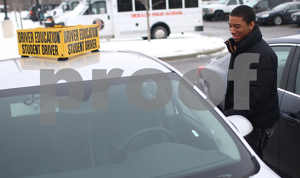 Kyle Bursaw – kbursaw@shawmedia.com<br /> <br /> DeKalb student Jaylen Cole, 15, smiles as he opens up the driver's side door of one of the high school's driver's education vehicles. Cole was on his second behind-the-wheel as part of the class.