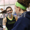 Kyle Bursaw – kbursaw@shawmedia.com<br /> <br /> Sycamore-DeKalb co-op gymnast Meredith Whisenhunt jokes with assistant coach Bri Dicus while waiting to get on one of the beams during practice at Energym on Friday, Feb. 1, 2013.
