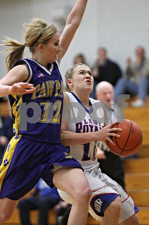Rob Winner – rwinner@shawmedia.com<br /> <br /> Paw Paw's Kasie Crawford (12) fouls Hinckley-Big Rock's Jacqueline Madden (10) in the first quarter during the Class 1A Hinckley-Big Rock Regional semifinal in Hinckley, Ill., Tuesday Feb.5, 2013