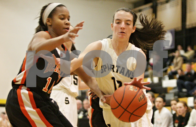 Rob Winner – rwinner@shawmedia.com<br /> <br /> DeKalb's Brittney Patrick (left) pressures Sycamore's Julia Henning in the first quarter in Sycamore, Ill., Thursday, Feb. 7, 2013. DeKalb defeated Sycamore, 50-26.