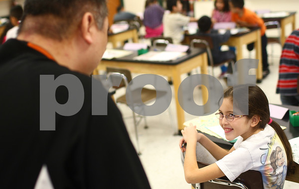Kyle Bursaw – kbursaw@shawmedia.com<br /> <br /> Founders Elementary third-grader Mayra Aburto talks with John Hahn about his injury on his first day back from a 14-month absence from teaching art on Tuesday, Jan. 29, 2013. Hahn suffered a ruptured brain aneurysm on November 21, 2011.