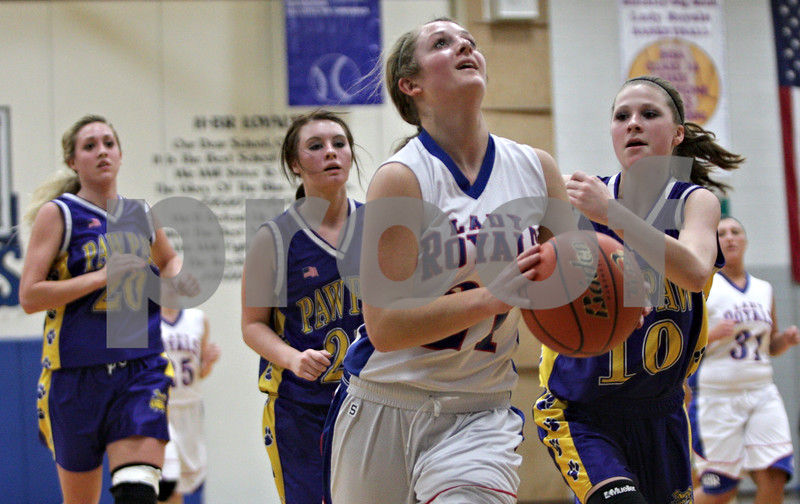 Rob Winner – rwinner@shawmedia.com<br /> <br /> After a steal, Hinckley-Big Rock's Lauren Paver (21) goes to the basket for two points in the first quarter against Paw Paw during the Class 1A Hinckley-Big Rock Regional semifinal in Hinckley, Ill., Tuesday Feb.5, 2013