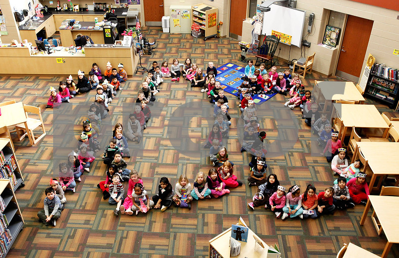 Erik Anderson - For the Daily Chronicle<br /> Cortland Elementary kindergartners pose as the number 100 to celebrate the 100th day of school at Cortland Elementary in Cortland on Friday, February 8, 2013. The students were made up of four classes with exactly 100 students in total.