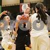Rob Winner – rwinner@shawmedia.com<br /> <br /> DeKalb's Courtney Bemis (3) controls a defensive rebound in the first quarter in Sycamore, Ill., Thursday, Feb. 7, 2013. DeKalb defeated Sycamore, 50-26.