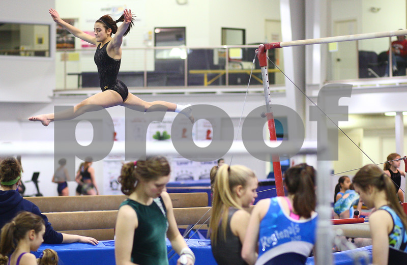 Kyle Bursaw – kbursaw@shawmedia.com<br /> <br /> Sycamore-DeKalb co-op gymnast Alison Morreale works on a routine on the beam during practice at Energym on Friday, Feb. 1, 2013.