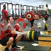 Kyle Bursaw – kbursaw@shawmedia.com<br /> <br /> Northern Illinois University football players Sean Folliard does front squats during a team lifting session in the Yordon Center on Friday, Feb. 1, 2013.