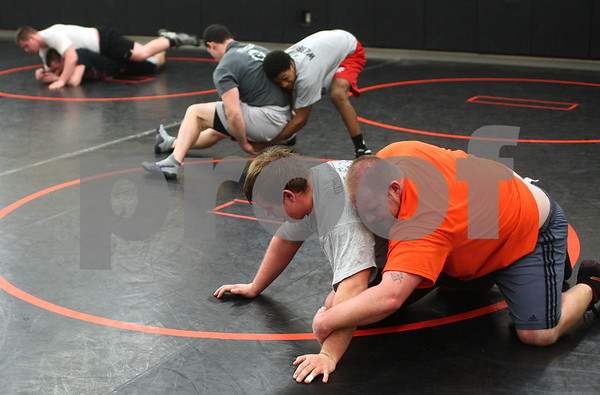 Kyle Bursaw – kbursaw@shawmedia.com<br /> <br /> Alex Roach (front center) wrestles with DeKalb assistant coach Travis Martin (front right) at practice on Tuesday, Feb. 5, 2013.