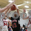Rob Winner – rwinner@shawmedia.com<br /> <br /> Indian Creek's Samantha Mosley (42) tries to shoot before being fouled by Amboy's Autumn Smith (left) in the first quarter during the Class 1A Hinckley-Big Rock Regional semifinal in Hinckley, Ill., Tuesday Feb.5, 2013.