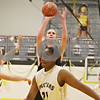 Rob Winner – rwinner@shawmedia.com<br /> <br /> DeKalb's Courtney Bemis (center) puts up a shot for two points in the second quarter in Sycamore, Ill., Thursday, Feb. 7, 2013. DeKalb defeated Sycamore, 50-26.