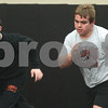 Kyle Bursaw – kbursaw@shawmedia.com<br /> <br /> Brothers Nick (left) and Alex Roach run sprints at the beginning of DeKalb wrestling practice on Tuesday, Feb. 5, 2013.