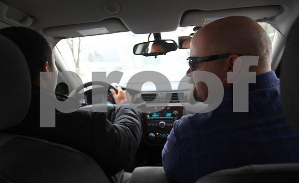 Kyle Bursaw – kbursaw@shawmedia.com<br /> <br /> DeKalb High School driver's education instructor Mark Sykes (right) advises student Jaylen Cole, 15, as he does a behind-the-wheel session on Tuesday, Feb. 5, 2013.