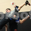 Kyle Bursaw – kbursaw@shawmedia.com<br /> <br /> DeKalb wrestler Nick Roach takes down teammate Howie Olsen at practice on Tuesday, Feb. 5, 2013.