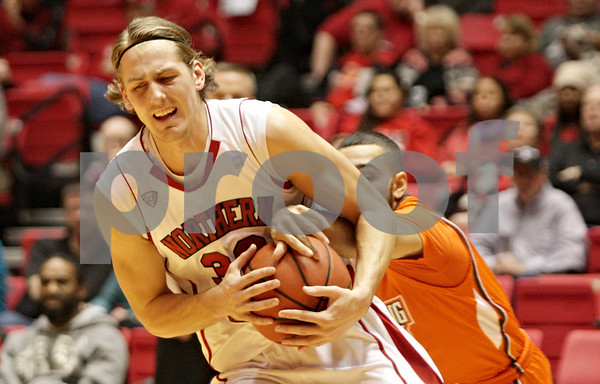 Rob Winner – rwinner@shawmedia.com<br /> <br /> Bowling Green's Jordan Crawford (right) reaches for a ball controlled by Northern Illinois' Aksel Bolin (front) during the first half in DeKalb, Ill., Wednesday, Feb. 6, 2013.