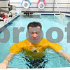 Kyle Bursaw – kbursaw@shawmedia.com<br /> <br /> DeKalb teacher John Hahn exercises his legs in a therapy pool at Unlimited Performance in Sycamore, Ill. following his first day back teaching on Tuesday, Jan. 29, 2013. Hahn has been working with physical therapist Melissa Stevens since November 2012 following a hip surgery that fixed an injury sustained when Hahn fell while having the aneurysm.
