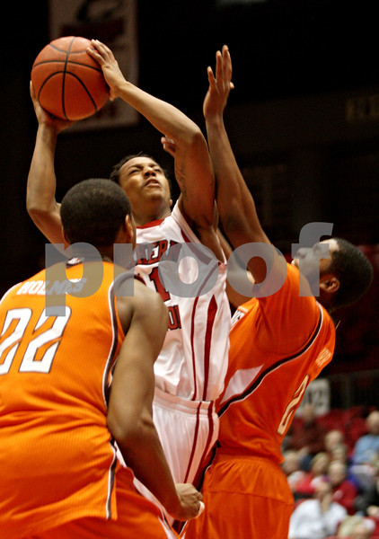Rob Winner – rwinner@shawmedia.com<br /> <br /> Northern Illinois' Daveon Balls (center) is fouled by Bowling Green's Chauncey Orr (right) during the first half in DeKalb, Ill., Wednesday, Feb. 6, 2013.