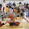 Rob Winner – rwinner@shawmedia.com<br /> <br /> Amboy's Brooke Lovgren (left) and Indian Creek's Jacklyn Bouma (right) struggle over a ball in the fourth quarter during the Class 1A Hinckley-Big Rock Regional semifinal in Hinckley, Ill., Tuesday Feb.5, 2013. Indian Creek defeated Amboy, 51-37.