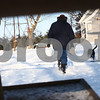 Kyle Bursaw – kbursaw@shawmedia.com<br /> <br /> Oaken Acres Operations Manager Christy Gerbitz and her dog Star move from one feeding area to the next as Gerbitz goes through her morning routine at Oaken Acres of putting out food for the various animals in Sycamore, Ill. on Wednesday, Feb. 6, 2013.