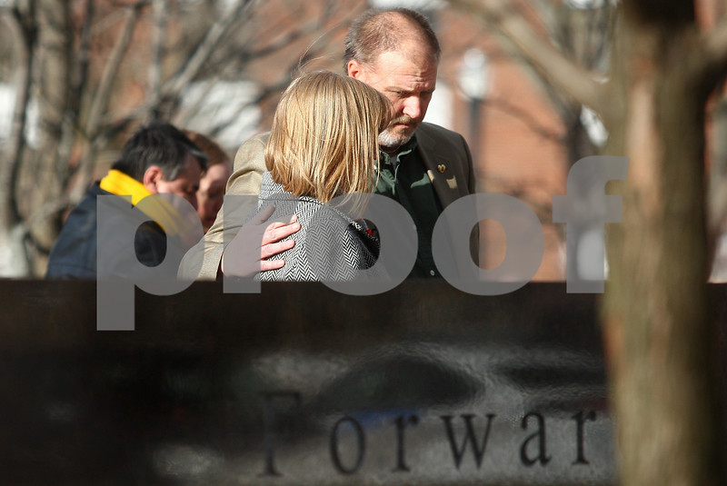 Kyle Bursaw – kbursaw@shawmedia.com<br /> <br /> After laying the wreath in front of the memorial for their daughter, Ryanne, Eric and Mary Kay Mace embrace for a moment in DeKalb, Ill. on Thursday, Feb. 14, 2013.