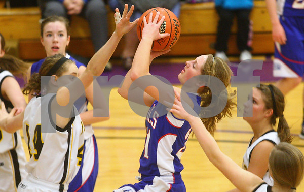 Kyle Bursaw – kbursaw@shawmedia.com<br /> <br /> Hinckley-Big Rock's Lauren Paver puts up a shot as Putnam County's Allison Voss fouls her in the second quarter of Hinckley-Big Rock's 40-32 victory over Putnam County in the Class 1A Oglesby Sectional at Illinois Valley Community College in Oglesby, Ill. on Monday, Feb. 11, 2013.