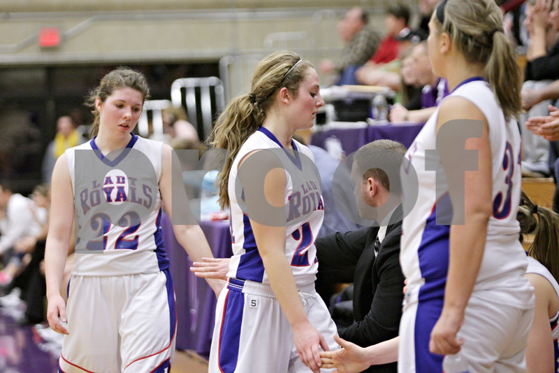 Rob Winner – rwinner@shawmedia.com<br /> <br /> Hinckley-Big Rock's Caitlin Flanigan (22) and Lauren Paver (center) head to the bench late in the fourth quarter during the Class 1A Oglesby Sectional final in Oglesby, Ill., Thursday, Feb. 14, 2013. Annawan defeated H-BR, 64-44.