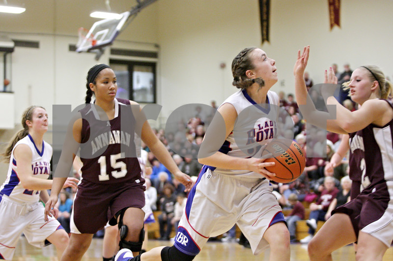 Rob Winner – rwinner@shawmedia.com<br /> <br /> Hinckley-Big Rock's Abbie Tosch (center) drives to the basket in the second quarter during the Class 1A Oglesby Sectional final in Oglesby, Ill., Thursday, Feb. 14, 2013. Annawan defeated H-BR, 64-44.