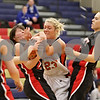 Rob Winner – rwinner@shawmedia.com<br /> <br /> DeKalb's Madelyne Johnson (23) is calle for fouling Huntley's Bethany Zornow while struggling for possession of a ball in the second quarter during the Class 4A Belvidere North Regional semifinal in Belvidere, Ill., Tuesday, Feb. 12, 2013.