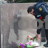 Kyle Bursaw – kbursaw@shawmedia.com<br /> <br /> Former DeKalb Fire Chief and current University of Notre Dame Fire Chief Bruce Harrison lays flowers at the memorial for each of the five killed in the 2008 shooting prior to the wreath-laying ceremony remembering them in DeKalb, Ill. on Thursday, Feb. 14, 2013.