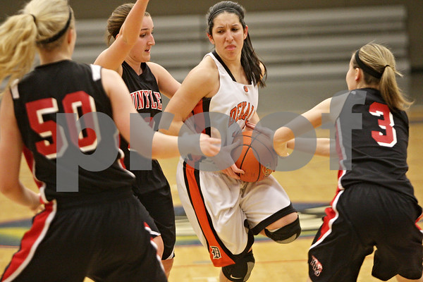 Rob Winner – rwinner@shawmedia.com<br /> <br /> DeKalb's Rahel Torres (center) is pressured by three Huntley defenders in the first quarter during the Class 4A Belvidere North Regional semifinal in Belvidere, Ill., Tuesday, Feb. 12, 2013.
