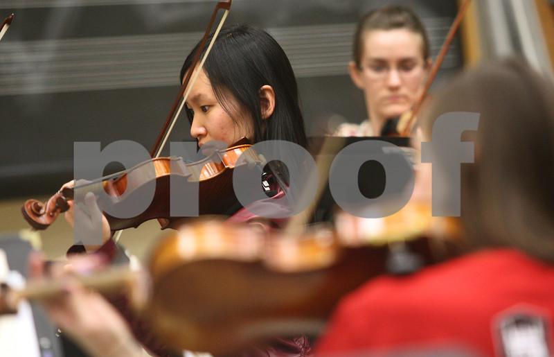 Kyle Bursaw – kbursaw@shawmedia.com<br /> <br /> Kishwaukee Symphony Orchestra violinist Hong Hong Hui performs with the group at practice in the NIU music building on  Monday, Feb. 4, 2013.