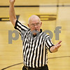 Rob Winner – rwinner@shawmedia.com<br /> <br /> Referee Denny Heins signals to the Sycamore sophomore girls basketball team during a game in Sycamore,Ill., Thursday, Feb. 7, 2013. Heins is an IHSA official who has been refereeing basketball for 50 years and is retiring.