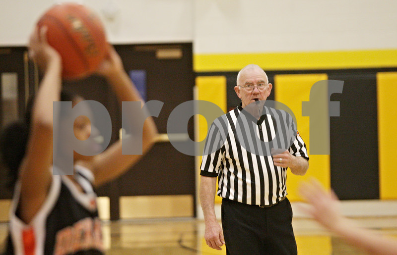 Rob Winner – rwinner@shawmedia.com<br /> <br /> Denny Heins referees during a sophomore girls basketball game in Sycamore,Ill., Thursday, Feb. 7, 2013. Heins is an IHSA official who has been refereeing basketball for 50 years and is retiring.