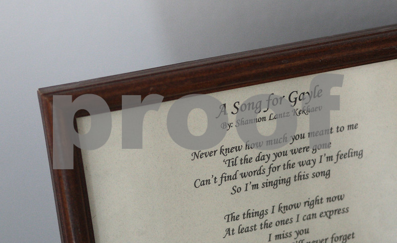 Kyle Bursaw – kbursaw@shawmedia.com<br /> <br /> The lyrics to 'A Song for Gayle' by Shannon Lantz Kekhaev, sits on display on a small table near the front door to Carol Stream, Ill. home of Gayle Dubowski's parents, the song was written after the NIU shooting in 2008 that claimed Gayle's life.<br /> <br /> Photographed in Carol Stream, Ill on Wednesday, Feb. 13, 2013.