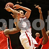 Rob Winner – rwinner@shawmedia.com<br /> <br /> Northern Illinois' Abdel Nader (23) attempts a shot between Ball State's Marcus Posley (3) and Bo Calhoun (12) in the first half of their game in DeKalb, Ill., Wednesday, Feb. 13, 2013. Ball State defeated NIU, 56-52.