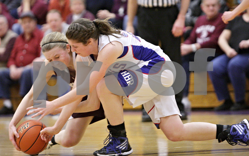 Rob Winner – rwinner@shawmedia.com<br /> <br /> Annawan's Maddie Jackson (left) and Hinckley-Big Rock's Caitlin Flanigan look to control a loose ball in the second quarter during the Class 1A Oglesby Sectional final in Oglesby, Ill., Thursday, Feb. 14, 2013.