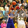 Kyle Bursaw – kbursaw@shawmedia.com<br /> <br /> Hinckley-Big Rock's Bridgette Edmeier passes over a Putnam County player in the first quarter of Hinckley-Big Rock's 40-32 victory in the Class 1A Oglesby Sectional at Illinois Valley Community College in Oglesby, Ill. on Monday, Feb. 11, 2013.