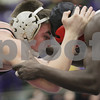 Rob Winner – rwinner@shawmedia.com<br /> <br /> Kaneland's Dan Goress competes against Rock Island's Jean-Louis Sawadago during their 145-pound finals match at the Class 2A Rochelle Sectional on Saturday, Feb. 9, 2013. Goress won with a 5-2 decision.
