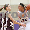 Rob Winner – rwinner@shawmedia.com<br /> <br /> Annawan's Morgan VanHyfte (33) pressures Hinckley-Big Rock's Bridgette Edmeier in the first quarter during the Class 1A Oglesby Sectional final in Oglesby, Ill., Thursday, Feb. 14, 2013.