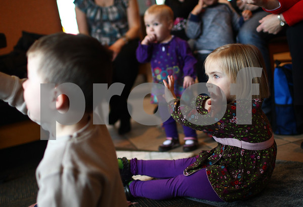 """Kyle Bursaw – kbursaw@shawmedia.com<br /> <br /> Josie Walter, 3, gestures along with the song """"Skinamarinkidinkidink"""" being led by DeKalb Public Library employee Marti Brown (not pictured) during Panera Story Time at Panera Bread in DeKalb, Ill. on Monday, Feb. 11, 2013. The story time happens on the second and fourth Monday of every month and parents can register at the DeKalb Public Library website at  <a href=""""http://www.dkpl.org"""">http://www.dkpl.org</a>"""