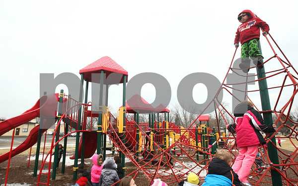 Kyle Bursaw – kbursaw@shawmedia.com<br /> <br /> Founders Elementary kindergartner Jesus Melchi Cruz looks over the playground from the top of a rope tower at recess on Thursday, Feb. 14, 2013.