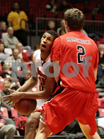 Rob Winner – rwinner@shawmedia.com<br /> <br /> Northern Illinois' Darrell Bowie (left) tries to drive past Ball State defender Matt Kamieniecki (2) in the second half of their game in DeKalb, Ill., Wednesday, Feb. 13, 2013. Ball State defeated NIU, 56-52.