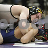 Rob Winner – rwinner@shawmedia.com<br /> <br /> Sycamore's Kyle Akins (top) controls Belvidere North's Ricardo Roman during their 113-pound finals match at the Class 2A Rochelle Sectional on Saturday, Feb. 9, 2013. Akins won by technical fall.