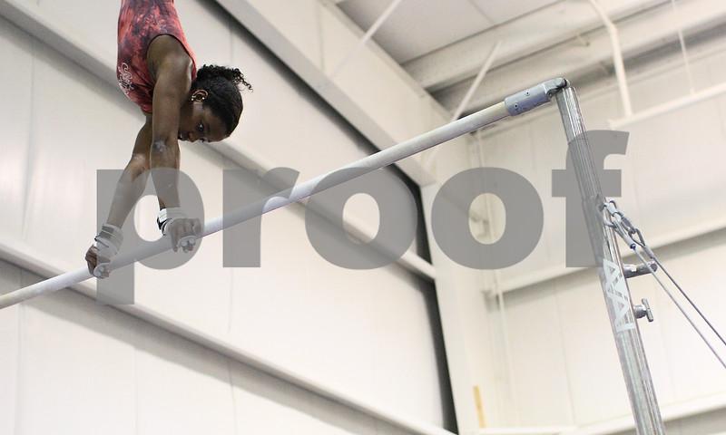Kyle Bursaw – kbursaw@shawmedia.com<br /> <br /> DeKalb-Sycamore gymnast Anita Bell practices on the uneven bars at Energym on Tuesday, Feb. 12, 2013.