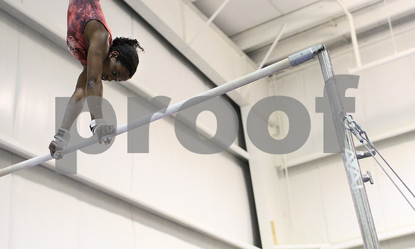 Kyle Bursaw – kbursaw@shawmedia.com<br /> <br /> DeKalb-Sycamore gymnast Anita Bell practices on the uneven bars at Energym on Tuesday, Feb. 12, 2013.