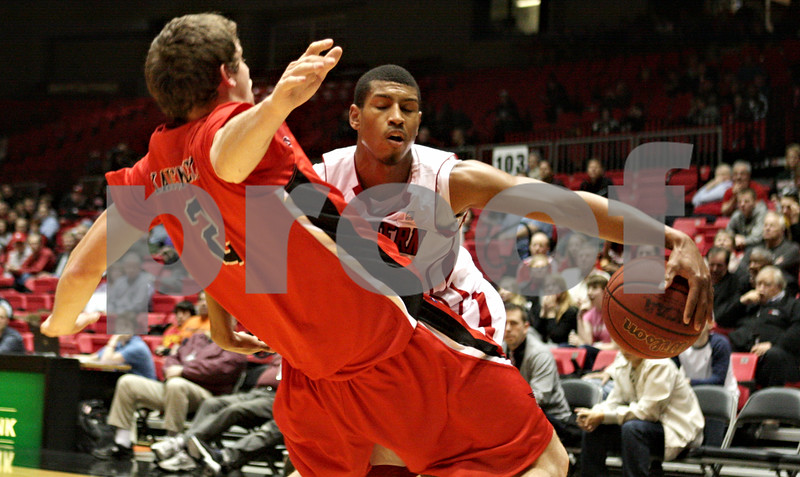 Rob Winner – rwinner@shawmedia.com<br /> <br /> Ball State's Matt Kamieniecki (2) unsuccessfully tries to draw a charging foul from Northern Illinois' Darrell Bowie (right) in the first half of their game in DeKalb, Ill., Wednesday, Feb. 13, 2013. Ball State defeated NIU, 56-52.