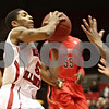 Rob Winner – rwinner@shawmedia.com<br /> <br /> Northern Illinois' Travon Baker (5) goes up for a shot before being fouled by Ball State's Jauwan Scaife (right) in the first half of their game in DeKalb, Ill., Wednesday, Feb. 13, 2013. Ball State defeated NIU, 56-52.