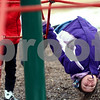 Kyle Bursaw – kbursaw@shawmedia.com<br /> <br /> Lillian Russie hangs upside-down from a rope tower on the playground at Founders Elementary at recess on Thursday, Feb. 14, 2013.